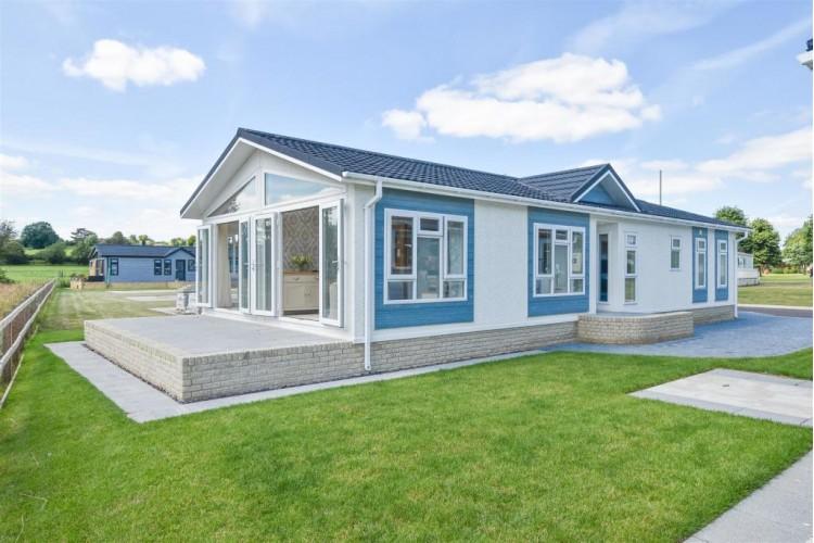 Brand New Omar Anniversary  50x22 Park home sited on a Brand new full Residential Plot